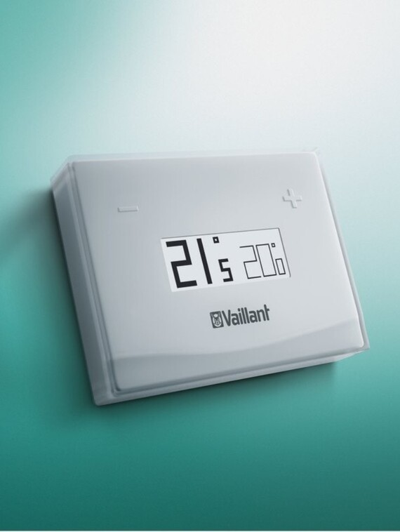 eRELAX control hanging on the wall, display showing temperature